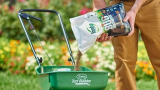 Roundup® For Lawns Bug Destroyer being poured into a Scotts fertilizer spreader.